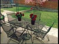 This wrought iron table & chairs is in great condition