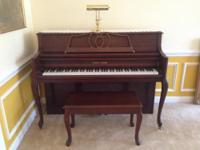 Young Chang piano and bench in excellent condition.
