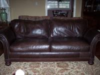 Beautiful chocolate brown, soft, leather sofa.