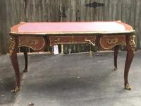 This is an unusually well crafted bureau plat, the