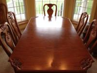 Beautiful oak dining room set. Includes table, 8 chairs