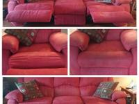 Deep red couch with a reclining chair on each end as