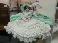 Beautiful doll with handmade crochet dress and silk
