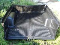 This is a black bed liner for a Chevy S10 king cab.