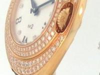 This is a Bedat, No.2 Midsize Rose Gold/Diamond Ladies