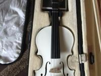 A white gently used beginners viola in great condition.