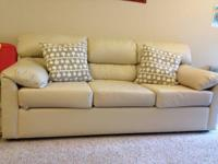 Beige color sofa for sale. 2 Pillows free with it. 3