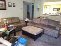 Beige Couch, Loveseat and OttomanCouch 84 ft long, 34