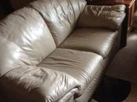 Use beige leather couch and love seat.  $200.00 obo