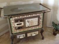 Chromed iron stove with decorative tiles.  Not