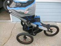 blue and black jogging stroller. Bell brand. Great