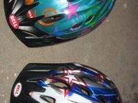 The turquoise helmet is labeled as a child's helmet;