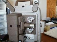 8mm movie projector. Oldie but goodie, works like it