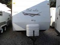 This model is a 30ft Bellair Travel Trailer. Includes