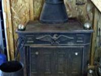 Free standing Ben Franklin replica wood burning stove.