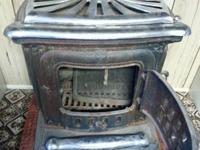 Ben Franklin cast iron original.  Burns wood, coal,