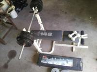 Bench press set up with weights. Things pictured. Good
