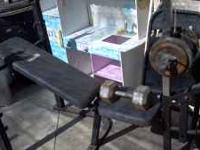 Selling my weight set. 2 bars +weights + benc canh.