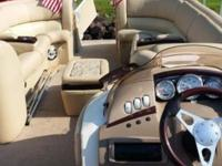 ABSOLUTELY STUNNING pontoon boat. Tan pleather