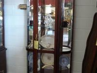 This curio cupboard is in exceptional condition. It has