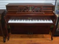 This dark satin mahogany console has quite a