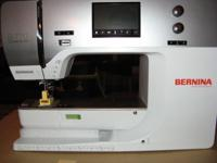 Bernina B770QE with embroidery arm holder are both
