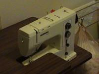 Sewing machine is a Bernina and it comes with table and