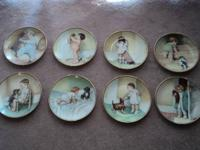 Bessie Gutmann collectable plates. A set of eight. Mint