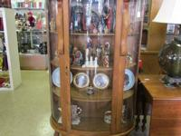 Beautiful beveled glass curio cabinet. A must see