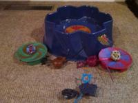 At least $50-$75 worth of Beyblades.  Hardly used.