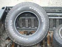 SET OF 4 TIRES- GREAT CONDITION ONLY 2K ON IT.CALL OR