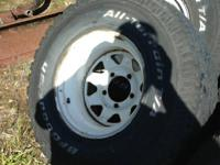 Set of 4 BF Goodrich TA tires mounted on white spoke