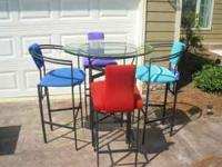 Breakfast or Bar table with 4 stools. $500 new. Good