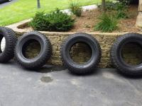 This listing is for four tires. They have 25,000 miles