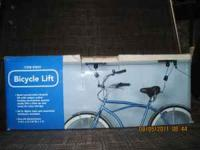 3 BICYCLE LIFTS-$10.00 EACH BRAND NEW CALL  Location: