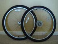 A set of bicycle rims and tires. Rims are AL-DH17 ALEX