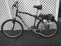 Schwinn bicycle with motor on it. Motor Bike gets about