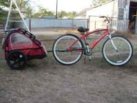 Bicycle with wide seat and child trailer. Handle bars