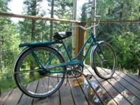 Murray brand made in 1963. Blue bike with luggage rack.