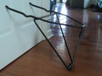 Metal bicycle storage rack to hang on your garage wall