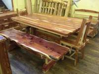We have this extra heavy built Cedar table with two