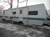 For sale is a Big Cheap 35' 1998 Coachmen Catalina with