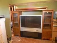 Have for sale a Big screen entertainment center with