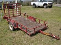Big Tex 4x8 Utility Trailer. Wooden floor, rear gate,