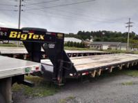 We have three 40' flat deck gooseneck trailers for