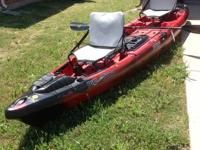 Red and black Big Tuna Jackson fishing kayak ... This