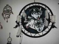 Up for sale is this big wolf dreamcatcher. It measures