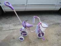 Adorable beginners bike with training wheels. Great for