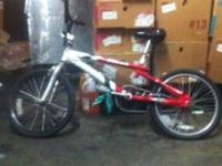 WHITE AND RED BIKE, SELLING FOR 50 INTERESTED CALL OR