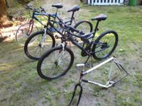 2 matching Mongoose Spectra dual suspension bikes.